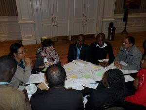 Workshop participants in group discussions considering the Three Horizons framework [Source: Felix Donkor]